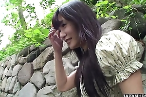 Adorable Asian brunette rubbing her soaking wet cunt