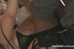Busty hotwife in stockings rides hard cock