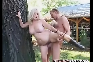 Busty Mature Acquires Facial Cumshot Outdoor