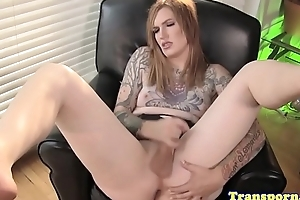 Tattooed tranny jerking her cock solo