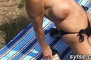 Threesome outdoor between 2 MILFs with strapon and a young man before gangbang